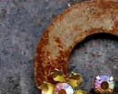 pendant,  industrial chic, rusty, rhinestone, diamonte,and enamel flowers on goldtone chain