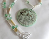 Mint green shell necklace Czech glass and silver plate