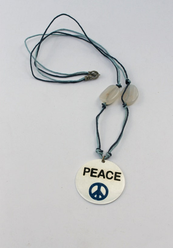 Blue peace necklace with hemp cord and fire agate beads