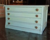 Old Sewing Spool Cabinet