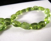 Peridot Faceted beads  24 pieces   6.5 inch strand