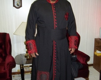 Custom Designed, Hand Made Black Cassock with Red Clergy Brocade Cloth and Pipping.Shown with Matching Waist Sash.