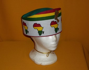 Ladies CrownTierra Hand Made of African Continent Cotton. White with A Golden Nefertitti on Black , Red, Green, and a touch of Gold.