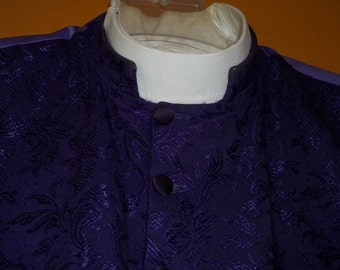 Clergy Vest made brom Bishops Purple Brocade. This four pocket Vest is custom made to wear with a Pontiff collar.