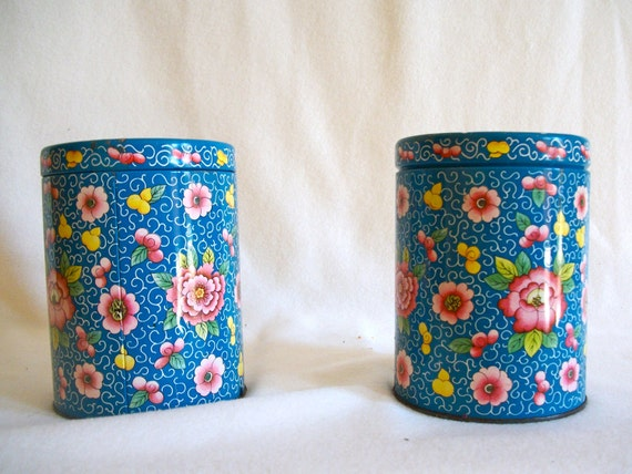 Sweet set of blue tins with pink and yellow flowers