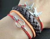 real brown braid bracelet- antique silver bird and arrow charm pendant