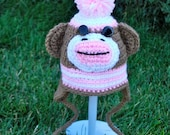 Hand crocheted, pink and brown, sock monkey hat w/striped band