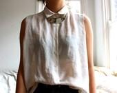 white sheer sleeveless button up top