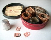Vintage Sewing Kit in Small Round Tin with Thimble, Thread, Needle Pack, Pink Metal Bra or Garter Connectors