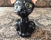 Cute little black cat ceramic figurine with pink ears