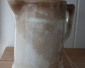 Antique milk pitcher