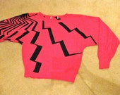 Vintage 1980s New Wave Hot Pink Sweater with a Black Lightning Bolt Pattern
