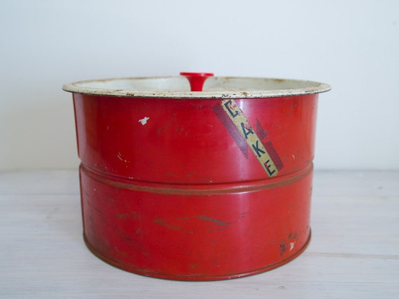 vintage rusty metal red cake tin