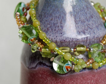 Sterling Silver, Semiprecious Stone, Glass, Dichroic Glass,and Peridot Twisted Double Stranded Bracelet