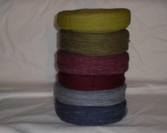 Un spun Icelandic knitting wool  in denim blue,burgundy and green.