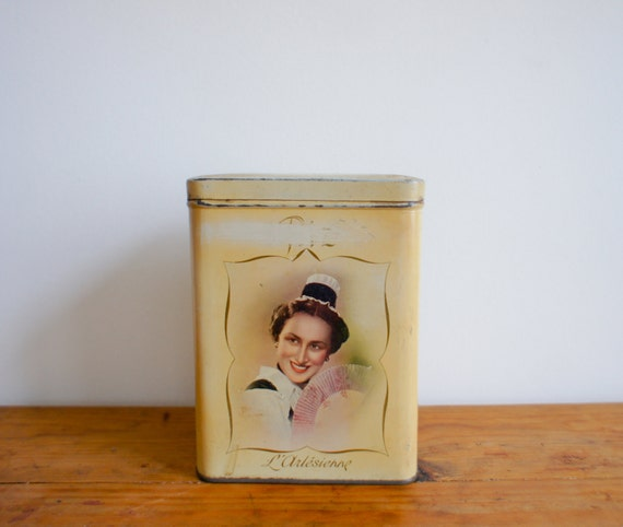 antique french food storage tin with french regional maiden from the 1940-50's