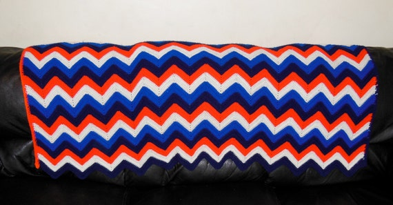 Red, White and Blue Knitted couch blanket.