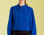 Royal blue pleated blouse