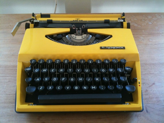 Laptop typewriter Adler Tippa made in Holland from the 60s (yellow)