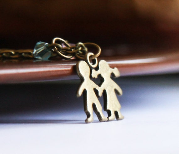 boy and necklace bronze cut out silhouette
