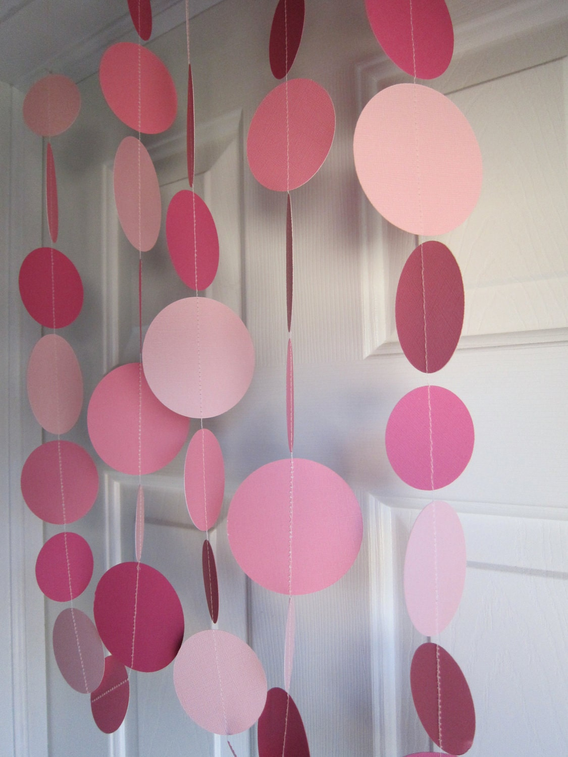 Pink paper garland baby shower baby girl birthday party for Baby girl birthday decoration pictures