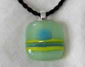 Glass pendant: Mint green with yellow and blue accents