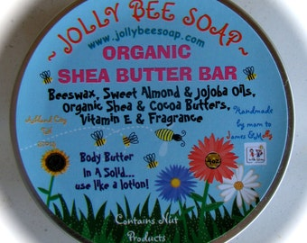 Large Organic Shea Butter Solid Lotion Bar.  Super charged with moisture. Scented in Raspberry Patchouli Oils.