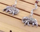 Elephant earrings - long antiqued silver