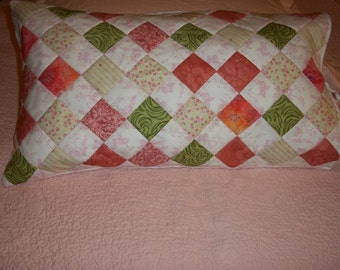 decorative quilted bed pillow cover in pink and green patchwork