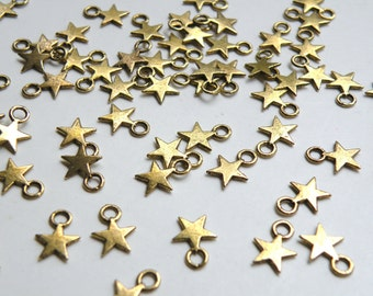 50 Tiny star charms antique gold plated 11x8mm DB00996