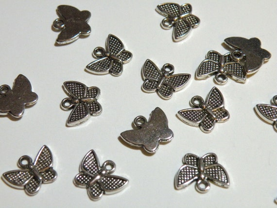 20 Little Butterfly charms antique silver plated 13x10mm DB00583