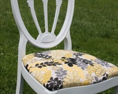 White accent chair with yellow and grey print fabric