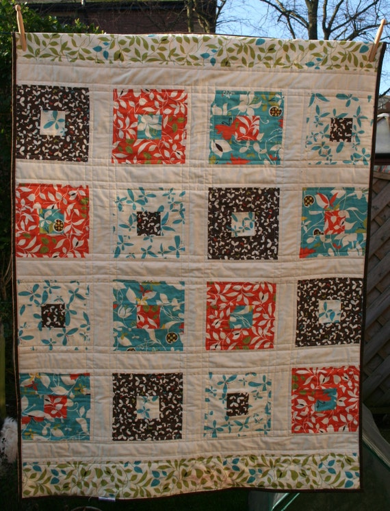 Handmade baby quilt / contemporary lap quilt in orange, blue and brown