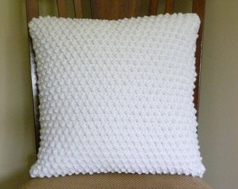 Textured crocheted white pillow cover