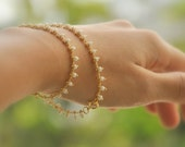 RESERVED for Sue //// Ellette  .tiny white seed beads .dainty gold bracelet