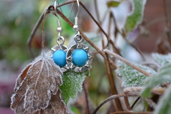 Stargate' charm earring with turquoise bead- Cancer Charity