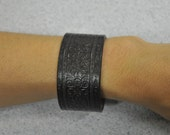 Dark brown leather cuff bracelet with embossed design