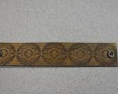 Brown cuff bracelet with floral design