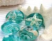 Teal Ocean glass lampwork beads set - lentil shape - SRA - green seafoam, beach
