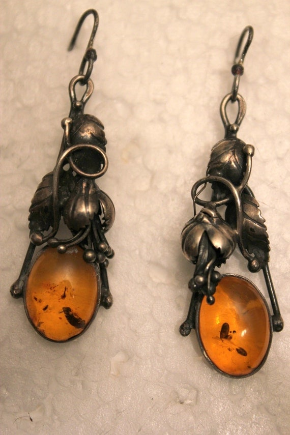A sterling silver vintage set of earrings with true amber around 1970