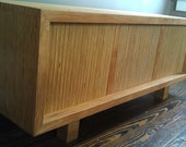 Entertainment console credenza in arauca and red birch by studiohoste