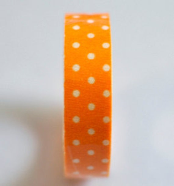 Orange with white polka dots fabric tape