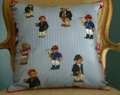 Adorable blue and white pin stripe pillows with some well dressed teddy bears.