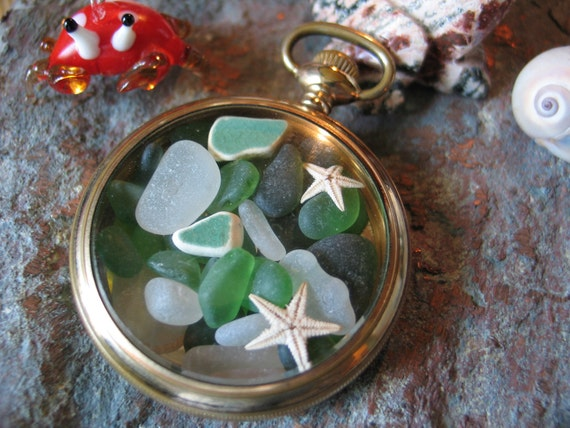 seaglass, starfish, and sea pottery necklace, encased in gold filled over 100 years old pocket watch.