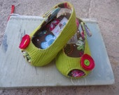 Green and hot pink baby shoes-sandals