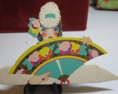 Art Deco 1920's-30's unused die cut gold gilded place card  glamour girl with fancy hat  holding  large fan Clark