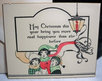 Art Deco 1920's-30's unused Christmas Card bobbed haired girls singing christmas carols hand colored with envelope