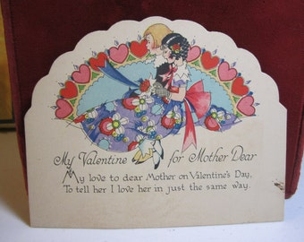 Unused 1920's-30's die cut valentines card to mother colorful graphics of young girl and boy surrounded by hearts rust craft