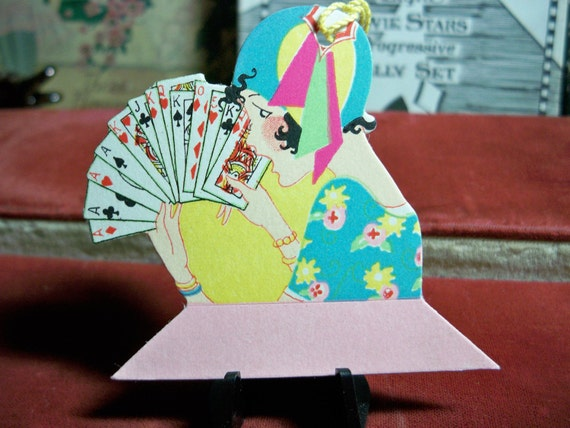 Art Deco Flapper wearing cloche hat holding playing cards Bridge Tally 1920's die cut