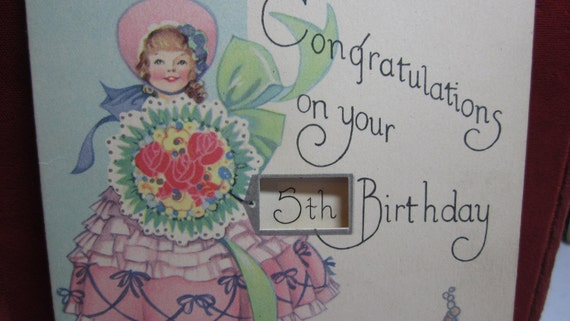 1930's art deco die cut   silver gilded birthday card for a five year old girl darling graphics of girl in pantaloons in a garden